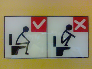 sitting vs squatting on toilet sign